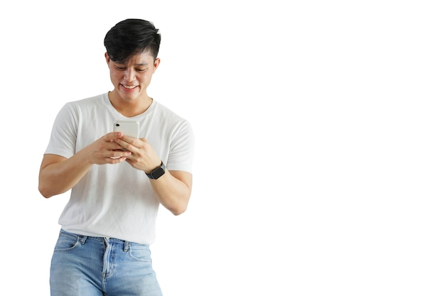 Young attractive asian man using smartphone with happy feeling isolated on white background