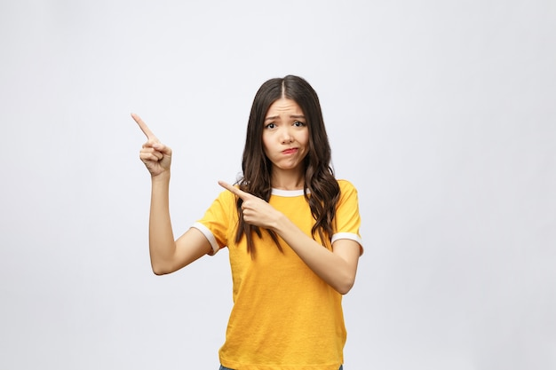 Young attractive asian woman who points to the finger with unhappy emotion