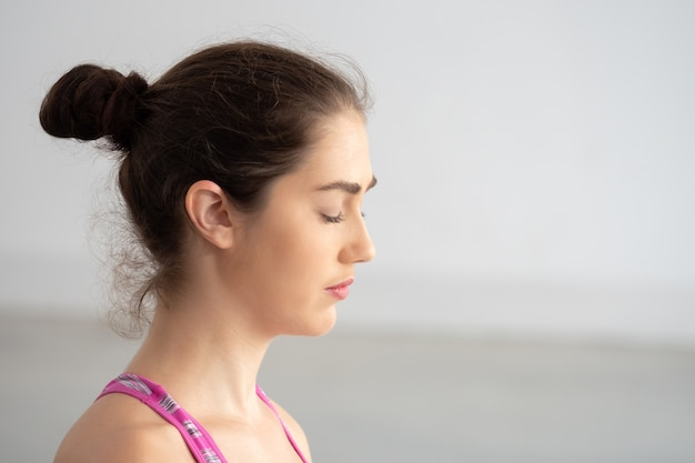 Young attractive caucasian woman closed eyes with mindfulness