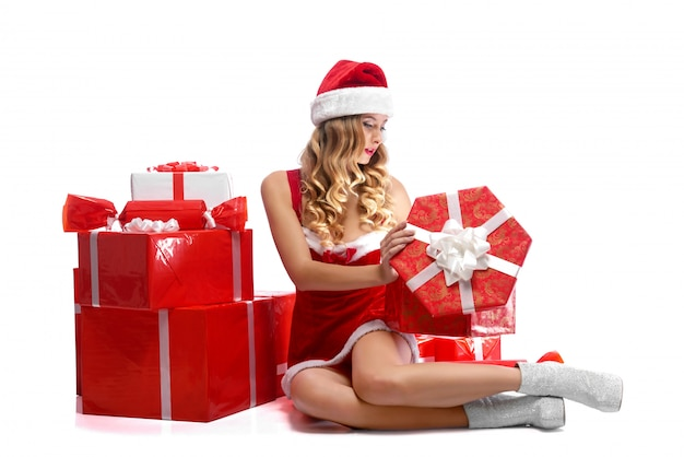 Young attractive female opening christmas presents