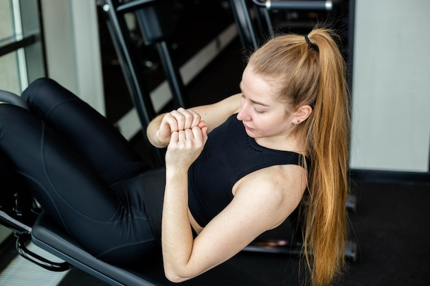 Young attractive girl in sportswear in a fitness club sports concept