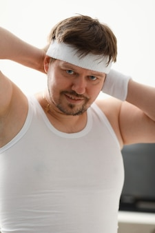 Young attractive man engaged in fitness