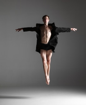 Young attractive modern ballet dancer jumping