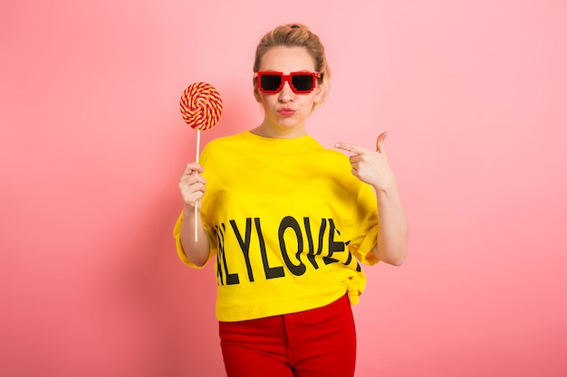 Young attractive womal with lollipop