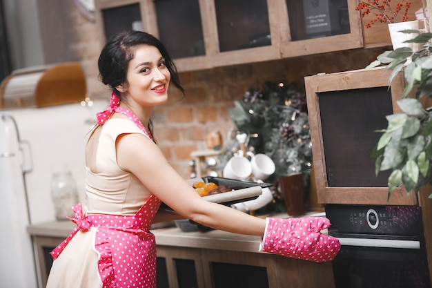 Young attractive woman baking