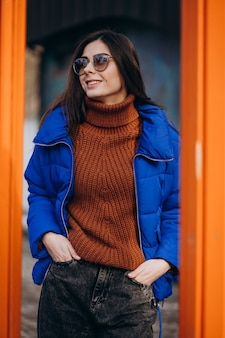 Young attractive woman in blue winter jacket