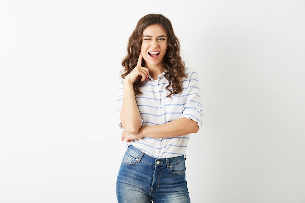 Young attractive woman dressed in casual outfit shirt and jeans, winking, smiling, hipster style, isolated,