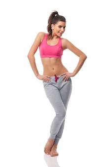Young attractive woman in exercise clothing