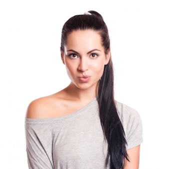 Young attractive woman face over isolated white background