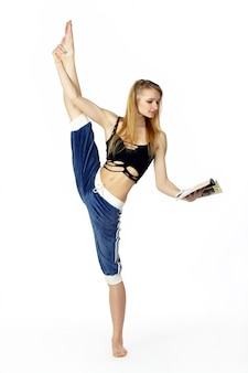 Young attractive woman fitness instructor reading