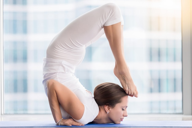 Young attractive woman in ganda bherundasana pose