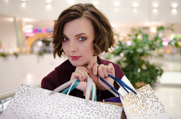 Young attractive woman holds shopping bags. shopping concept
