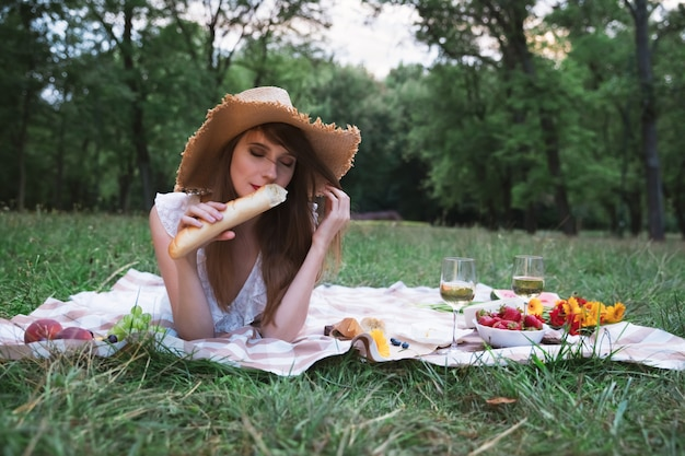 Young attractive woman on a picnic in a city park