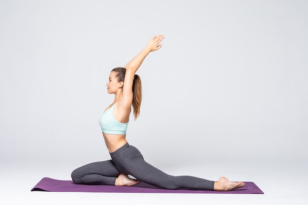 Young attractive woman practicing fitness, standing in lunge exercise, yoga pose, working out wearing sportswear, isolated