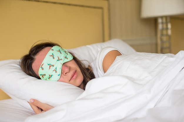 Young attractive woman sleeping in the bed
