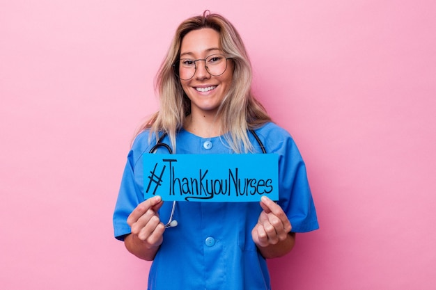 Young australian nurse woman holding a international nurses day placard isolated on blue background