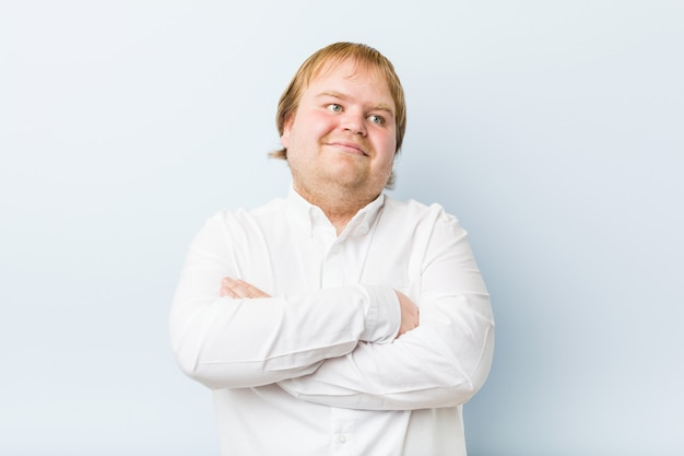 Young authentic redhead fat man smiling confident with crossed arms.