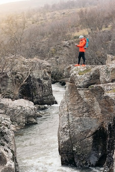 Young backpacker enjoying of nature. mountaineer concept.