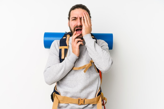 Young backpacker man isolated on a white whining and crying disconsolately.