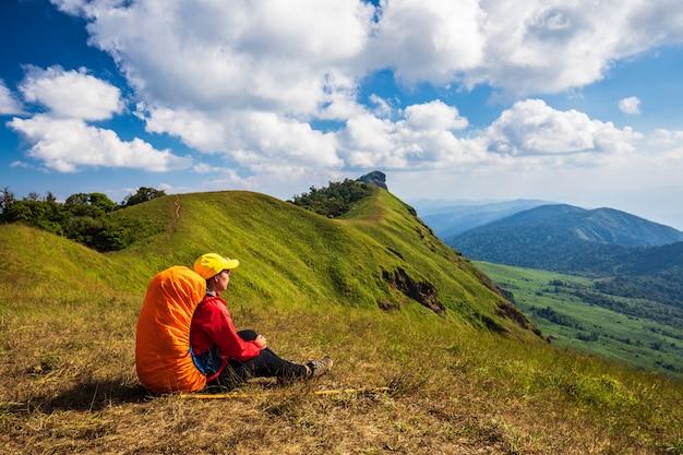 Young backpacking woman hiking on mountains. doi mon chong, chiangmai, thailand.