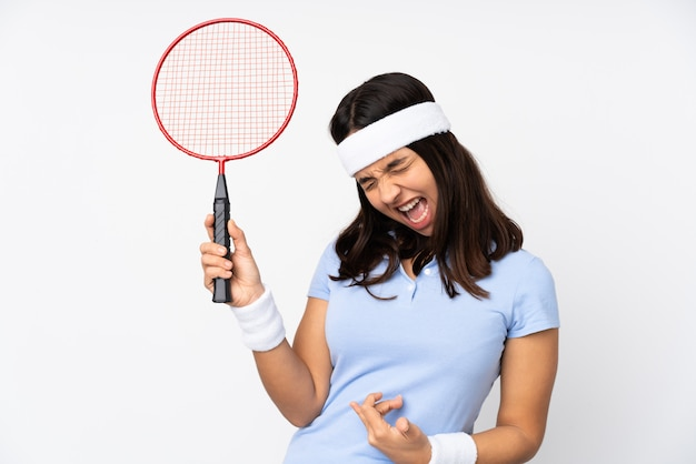 Young badminton player woman over isolated white wall making guitar gesture