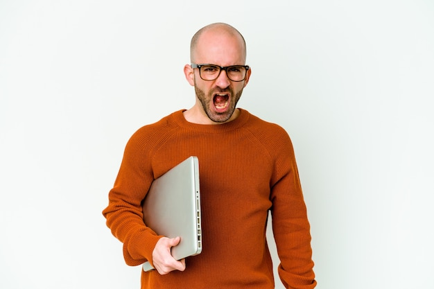 Young bald man holding a laptop isolated