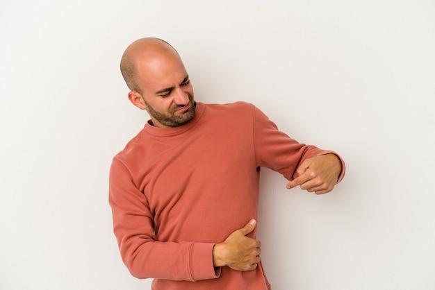 肝臓の痛み、胃の痛みを持っている白い背景で隔離の若いハゲ男。