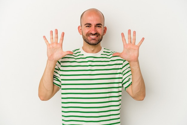 Young bald man isolated on white background showing number ten with hands.