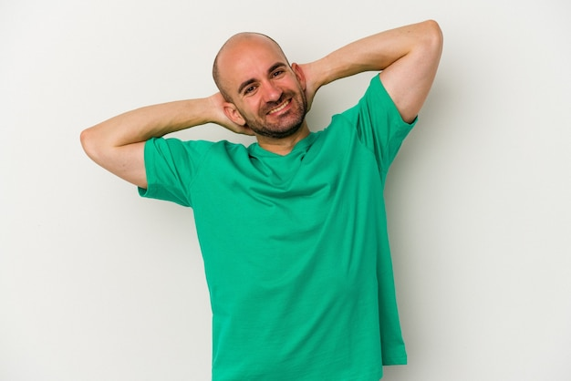 Young bald man isolated on white background stretching arms, relaxed position.