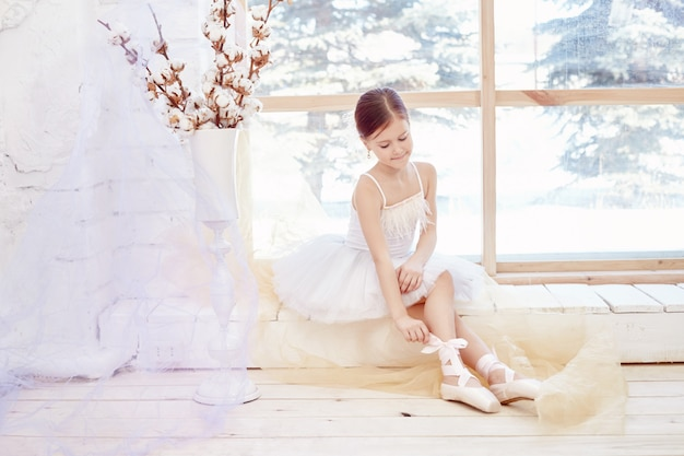 Young ballerina girl preparing ballet performance