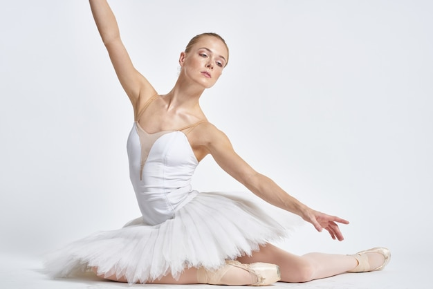 Young ballerina posing. white backgorund.