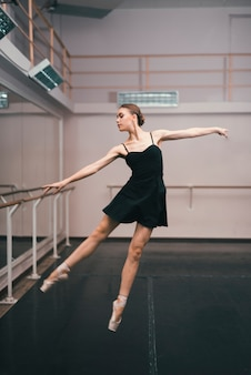 Young ballerina practising in the dance studio