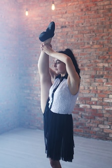 Young ballerina stretching