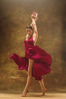Young ballet dancer. harmonious pretty woman with dress