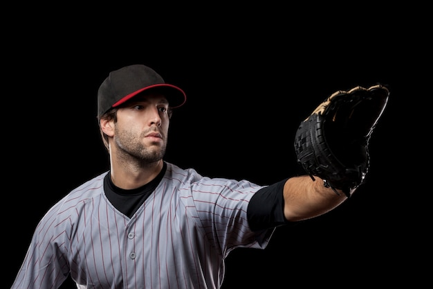 Young baseball player with a black cap