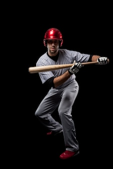 Young baseball player with a red helmet