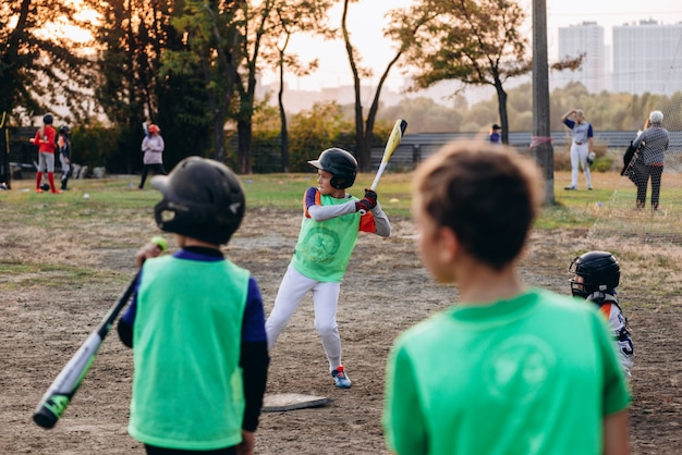 Young baseball players are playing, one of them is preparing to strike