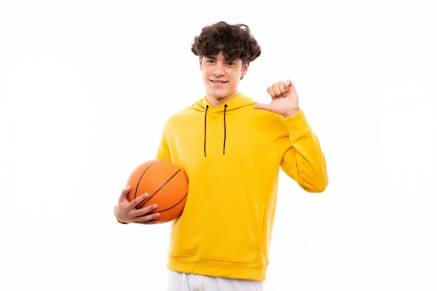 Young basketball player man over isolated white wall proud and self-satisfied