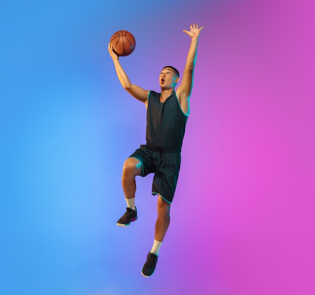Young basketball player in neon light