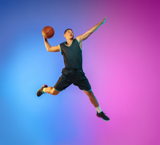 Young basketball player in neon light Free Photo