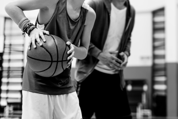 Young basketball player shoot