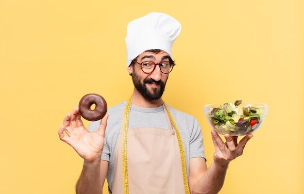 젊은 수염된 요리사 남자 의심 또는 불확실한 표정