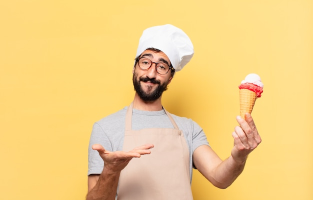 Young bearded chef man happy expression and holding an ice cream