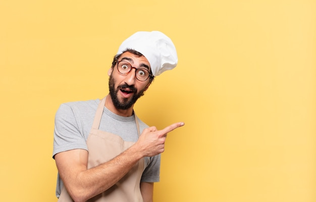 Young bearded chef man scared expression