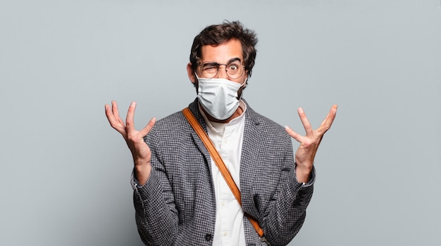 Young bearded crazy businessman with a covid mask