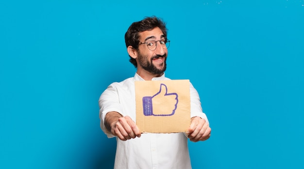 Young bearded crazy man holding a social media like banner