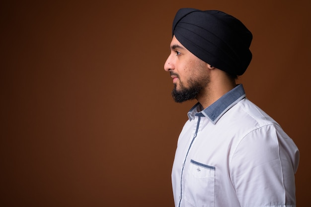 Young bearded indian sikh man wearing turban