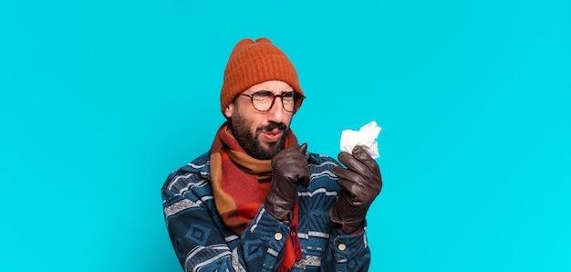 젊은 수염 남자와 겨울 옷을 입고. 질병 개념