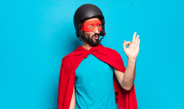 Young bearded man. crazy and humorous super hero with helmet and mask