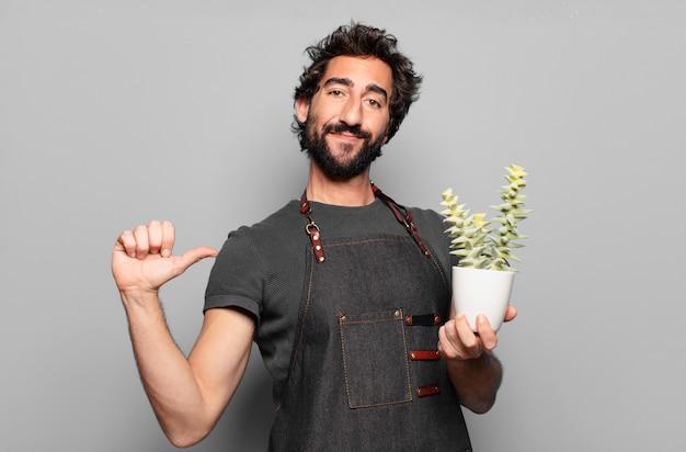 젊은 수염 된 남자 정원사 개념